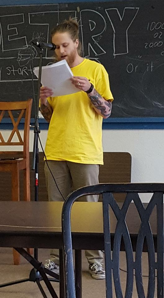 Me reading at CatFest 2016.jpeg